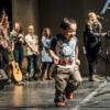 Boy running on stage